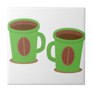 Two green coffees mugs tile