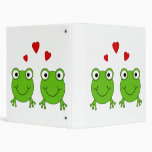 Two green frogs with red hearts. 3 ring binders