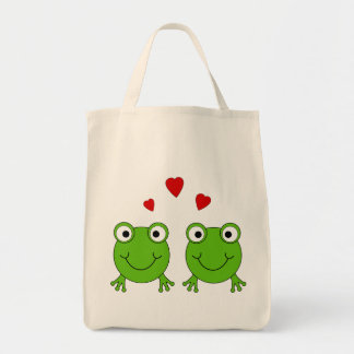 Two green frogs with red hearts. grocery tote bag