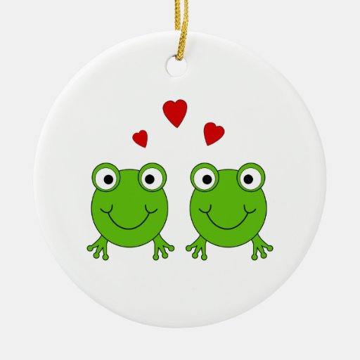 Two green frogs with red hearts. ceramic ornament