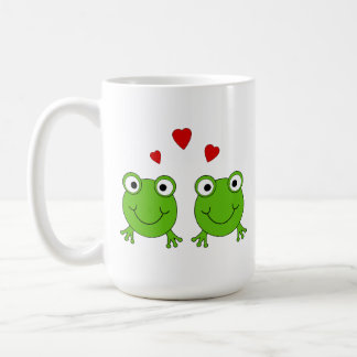 Two green frogs with red hearts. coffee mug