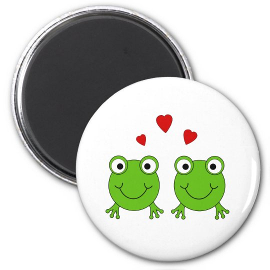 Two green frogs with red hearts. magnet