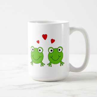 Two green frogs with red hearts. mugs