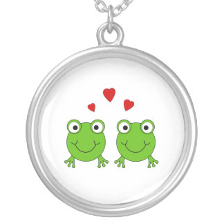 Two green frogs with red hearts. jewelry
