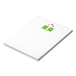 Two green frogs with red hearts. memo notepad