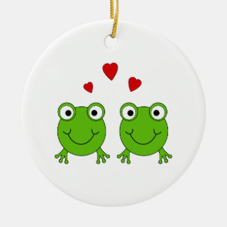 Two green frogs with red hearts ornaments