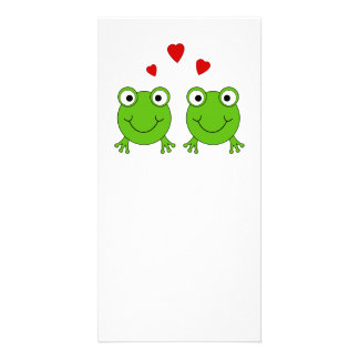 Two green frogs with red hearts. photo card template