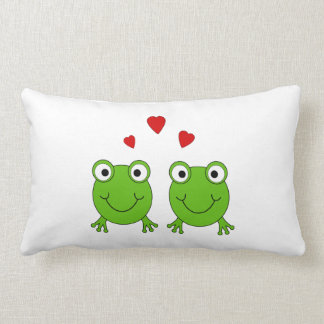 Two green frogs with red hearts. throw pillow