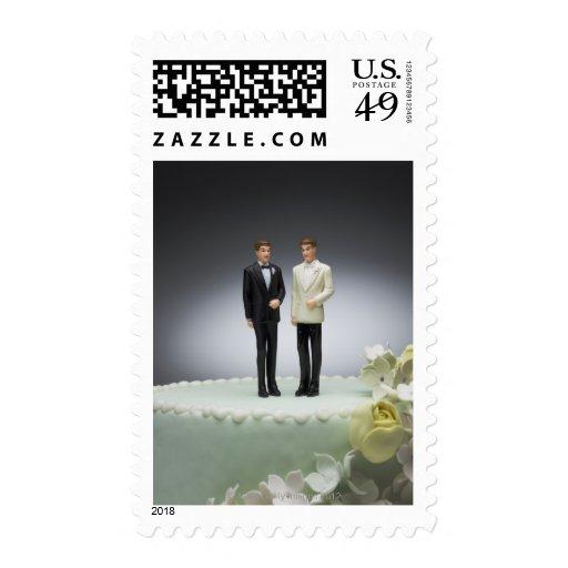 Two groom figurines on top of wedding cake postage stamp