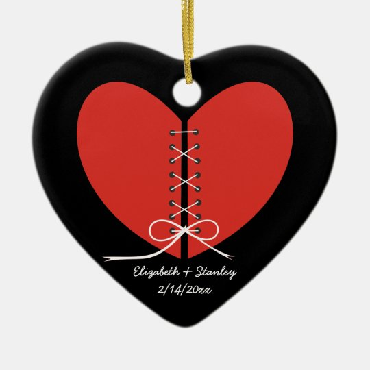 Two halves of a heart tied with a ribbon ornament