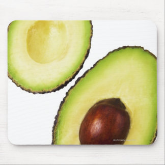 Two halves of an an avocado, on white mouse pad
