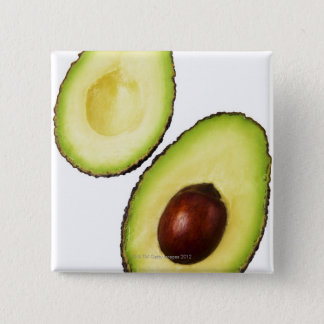 Two halves of an an avocado, on white pinback button