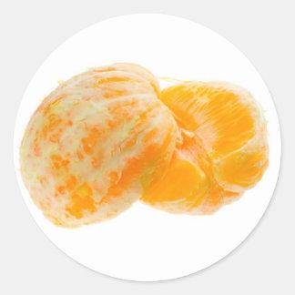 Two halves of peeled orange classic round sticker
