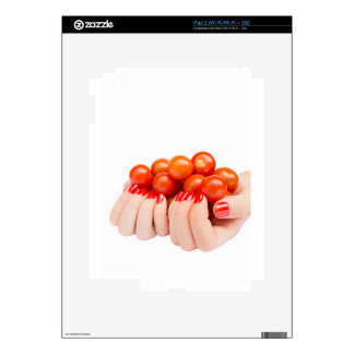 Two hands holding cherry tomatoes decals for iPad 2