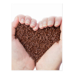 Two hands holding chocolate sprinkles postcard