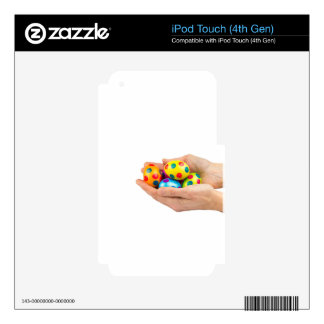 Two hands holding  painted easter eggs on white decals for iPod touch 4G
