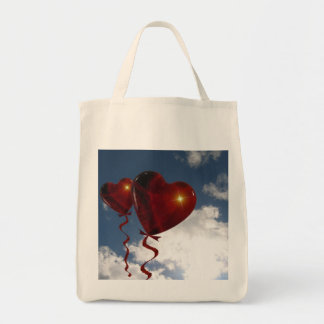 Two heart balloons in clouded sky tote bag