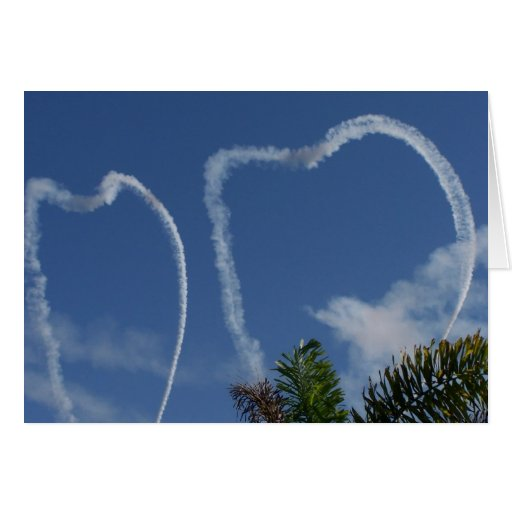 two hearts drawn by airplanes over palm trees.jpg greeting cards