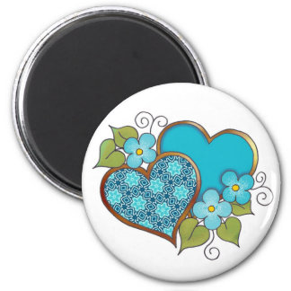 Two hearts with blossoms aqua 2 inch round magnet