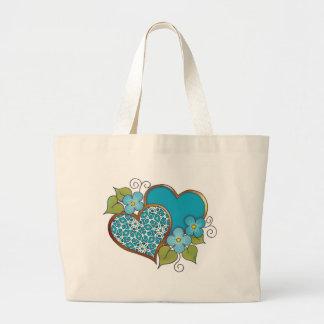 Two hearts with blossoms aqua jumbo tote bag
