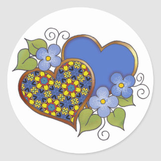 Two hearts with blossoms primary colors classic round sticker
