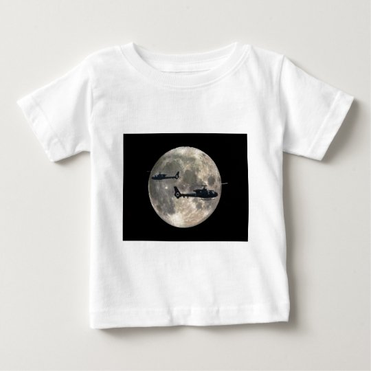 two helicopters silhouetted by a full moon baby T-Shirt