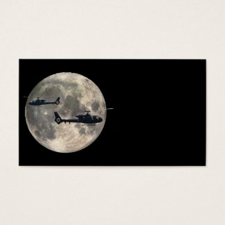 two helicopters silhouetted by a full moon business card
