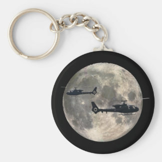 two helicopters silhouetted by a full moon keychain