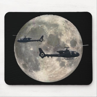 two helicopters silhouetted by a full moon mouse pad