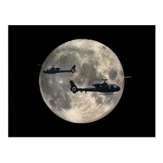two helicopters silhouetted by a full moon postcard