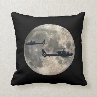 two helicopters silhouetted by a full moon throw pillow