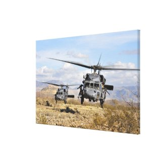 Two HH-60 Pavehawk helicopters preparing to lan Canvas Print