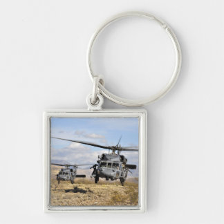 Two HH-60 Pavehawk helicopters preparing to lan Keychain