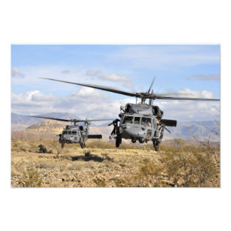 Two HH-60 Pavehawk helicopters preparing to lan Photo Print