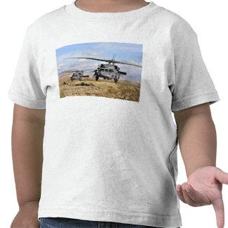 Two HH-60 Pavehawk helicopters preparing to lan Tshirts