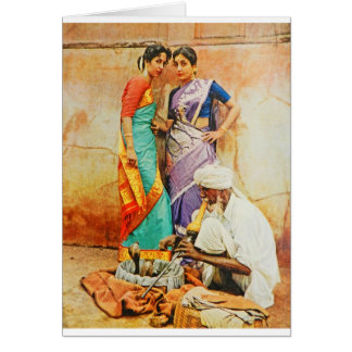 two hindu women with a snake handler card