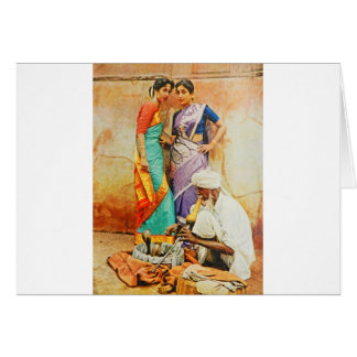 two hindu women with a snake handler greeting card