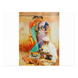 two hindu women with a snake handler postcard