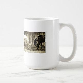 Two horses grazing coffee mug