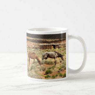 Two horses grazing, Monument Valley, UT Coffee Mug