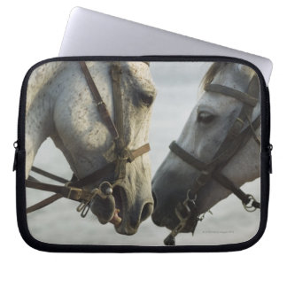 Two horses meeting. laptop sleeve