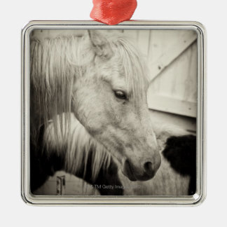 two horses outside a stable- black and white metal ornament