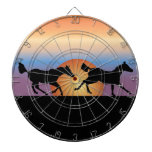 Two horses running against a sunrise dartboards