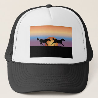 Two horses running against a sunrise trucker hat