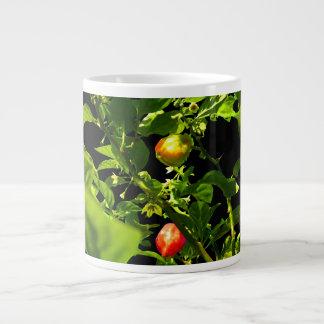 two hot peppers green foliage black back.jpg large coffee mug