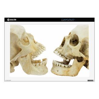 Two human skulls opposite of each other laptop skin