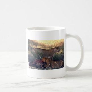 Two hungry female lions coffee mug