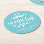 "Two if By Sea | Personalized Wedding Round Paper Coaster<br><div class=""desc"">Perfect for your wedding cocktail hour,  engagement party or rehearsal dinner,  these cute nautical style coasters feature &quot;two less fish in the sea&quot; in white brush script lettering,  with two kissing fish on a vibrant turquoise aqua background. Personalize with your names and wedding date or location along the bottom.</div>"
