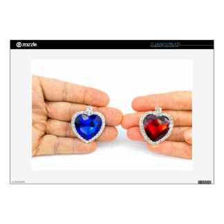 Two jewelry hearts on hand of man and woman laptop decals