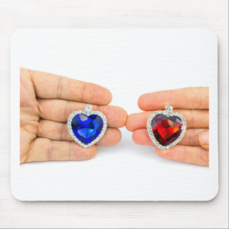 Two jewelry hearts on hand of man and woman mouse pad